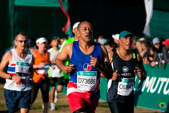 Southern Striders Athletic Club member running a race with a group of men